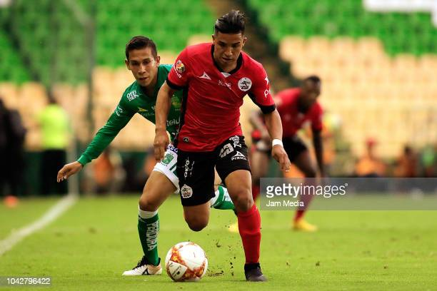 Michaell Chirinos of Lobos BUAP and Alexander Mejia of Leon competes for the ball during the 10th round match between Leon and Lobos BUAP as part of...