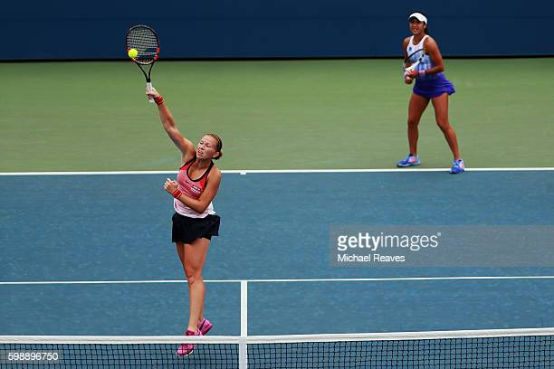 Michaella Krajicek of Netherlands and Heather Watson of the United Kingdom in action against Nao Hibino of Japan and Nicole Gibbs of the United...