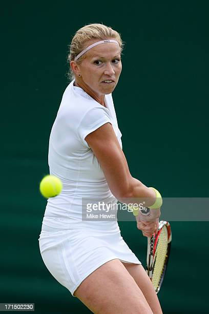 Michaella Krajicek of Netherlands in action against Na Li of China during their Ladies' Singles first round match on day two of the Wimbledon Lawn...