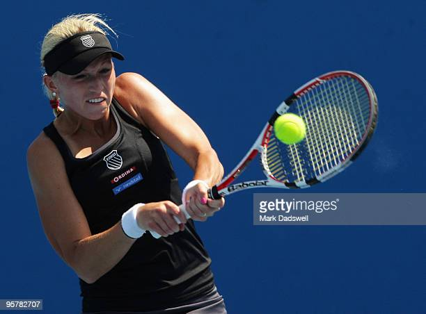 Michaella Krajicek of the Netherlands hits a backhand in her Women's Qualifying second round match against Laura Robson of Great Britain ahead of the...