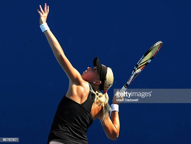 Michaella Krajicek of the Netherlands hits a serve in her Women's Qualifying second round match against Laura Robson of Great Britain ahead of the...