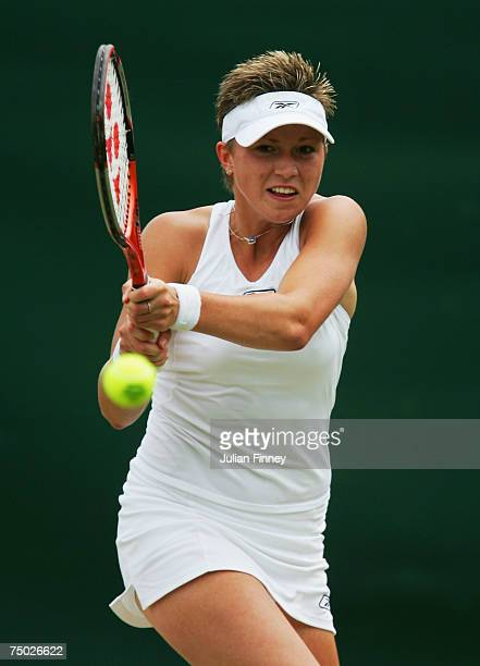 Michaella Krajicek of the Netherlands plays a backhand during the Women's Singles quarter finals match against Marion Bartoli of France during day...