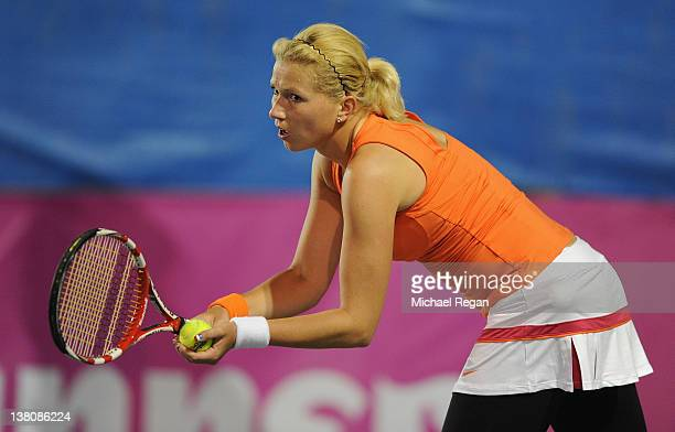 Michaella Krajicek of the Netherlands serves in her match with Elena Baltacha of Great Britain during the tie between Great Britain and the...