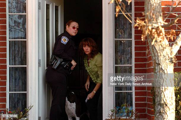 Michaella Oefelein exwife of astronaut William Oefelein opens the door to her Houston home for a police officer Lisa Marie Nowak a 43yearold Navy...