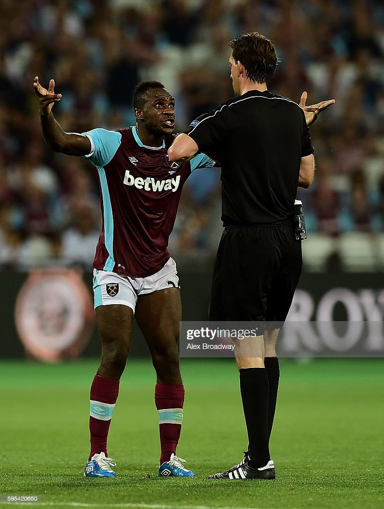 Michail Anotonio of West Ham remonstrates with referee Manuel Grafe during the UEFA Europa League match between West Ham United and FC Astra Giurgiu at the Olympic Stadium on August 27, 2016 in London, England.