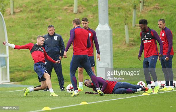 Michail Antonio of England goes to ground after a challenge by Jamie Vardy during a training session at St George's Park on September 3 2016 in...