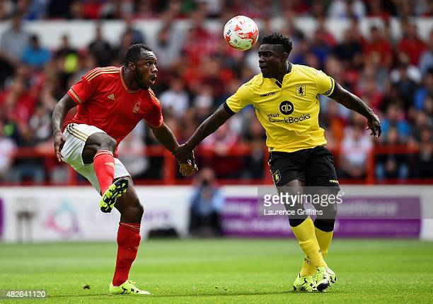 Michail Antonio of Nottingham Forest battles with Micah Richards of Aston Villa during the Pre Season Friendly match between Nottingham Forest and...