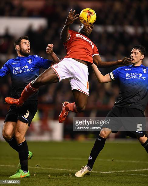 Michail Antonio of Nottingham Forest battles with Steve Cook and Tommy Elphick of Bournemouth during the Sky Bet Championship match between...