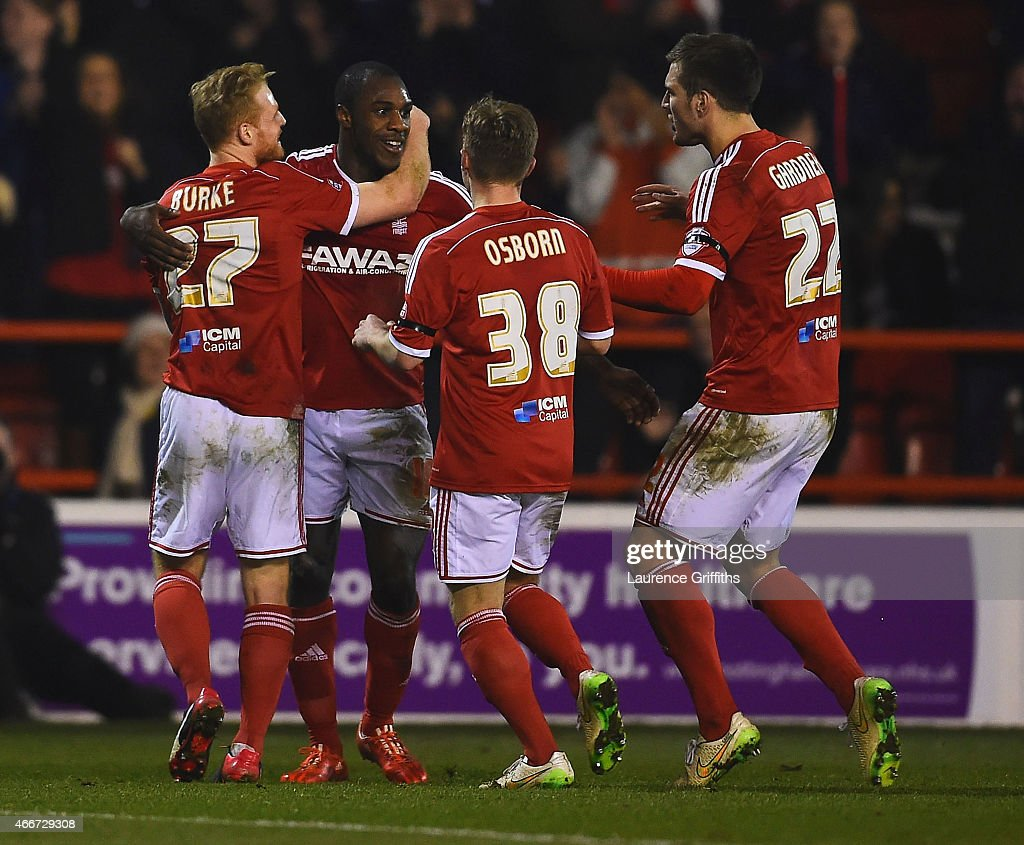 Michail Antonio of Nottingham Forest (2L) celebrates with team mates as he scores their second goal during the Sky Bet Championship match between Nottingham Forest and Rotherham at City Ground on March 18, 2015 in Nottingham, England.