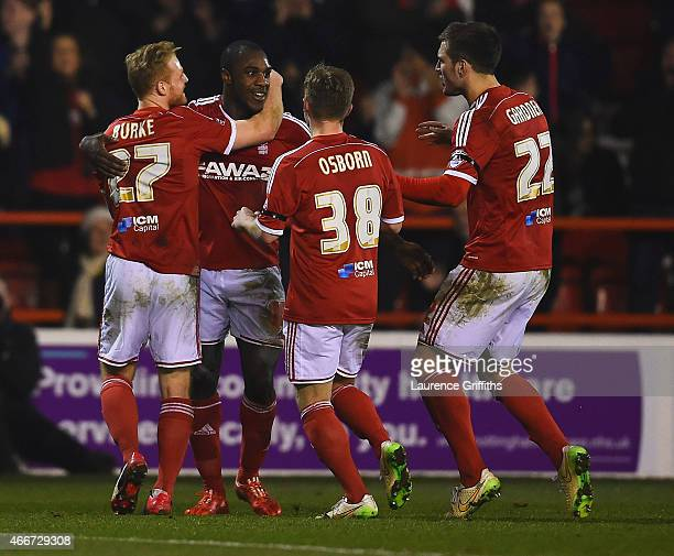 Michail Antonio of Nottingham Forest celebrates with team mates as he scores their second goal during the Sky Bet Championship match between...