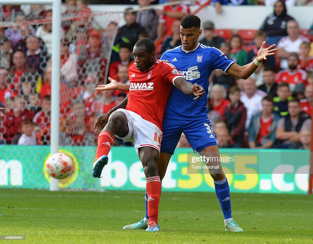 Michail Antonio of Nottingham Forest holds off a challenge from Tyrone Mings of Ipswich Town during the Sky Bet Championship match between Nottingham Forest and Ipswich Town at City Ground on October 5, 2014 in Nottingham, England.