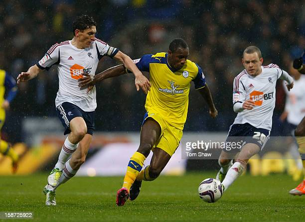 Michail Antonio of Sheffield tussles with Keith Andrews of Bolton during the npower Championship match between Bolton Wanderers and Sheffield...