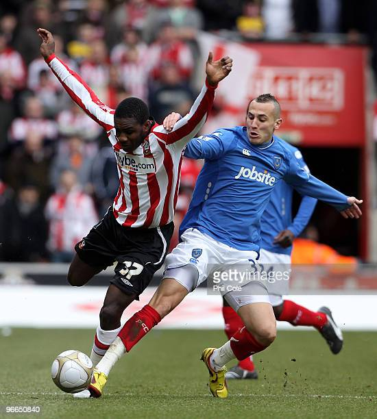 Michail Antonio of Southampton gets tackled by Hasan Yebda of Portsmouth during the FA Cup sponsored by E.ON fifth round match between Southampton...