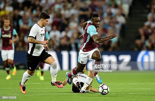 Michail Antonio of West Ham advances under pressure from Christian Sapunaru of FC Astra Giurgiu during the UEFA Europa League match between West Ham...
