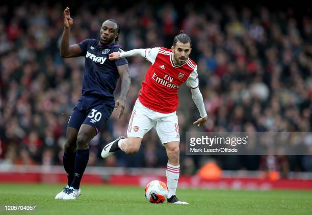 Michail Antonio of West Ham and Dani Ceballos of Arsenal during the Premier League match between Arsenal FC and West Ham United at Emirates Stadium...