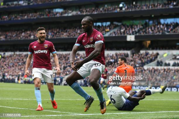 Michail Antonio of West Ham celebrates with Robert Snodgrass after scoring the winning goal during the Premier League match between Tottenham Hotspur...
