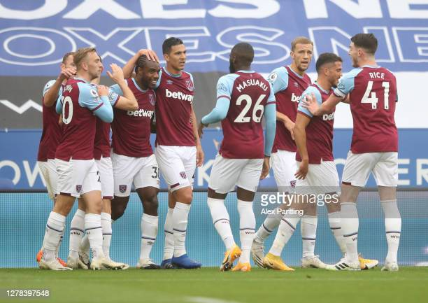 Michail Antonio of West Ham celebrates with teammates after scoring his sides first goal during the Premier League match between Leicester City and...