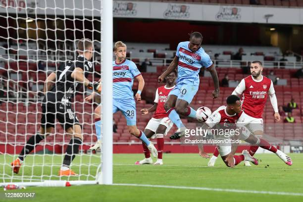 Michail Antonio of West Ham comes close but his shot is saved by Arsenal goalkeeper Bernd Leno during the Premier League match between Arsenal and...