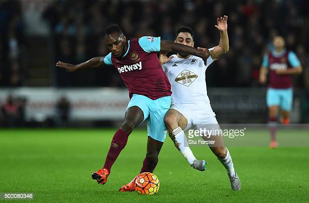 Michail Antonio of West Ham holds off the challenge from Neil Taylor of Swansea City during the Barclays Premier League match between Swansea City...