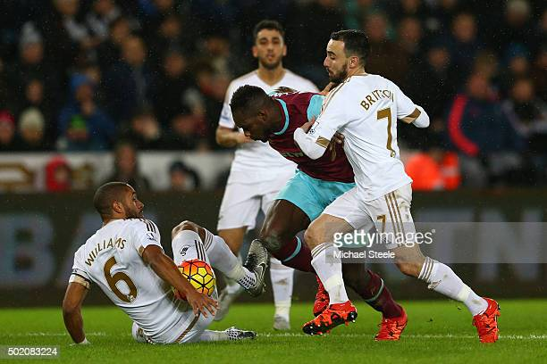 Michail Antonio of West Ham is closed down by Ashley Williams and Leon Britton of Swansea City during the Barclays Premier League match between...