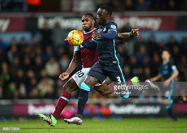 Michail Antonio of West Ham United and Bacary Sagna of Manchester City battle for the ball during the Barclays Premier League match between West Ham...