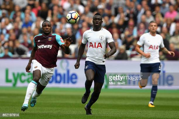 Michail Antonio of West Ham United and Davinson Sanchez of Tottenham Hotspur battle for possession during the Premier League match between West Ham...