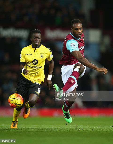 Michail Antonio of West Ham United and Idrissa Gueye of Aston Villa compete for the ball during the Barclays Premier League match between West Ham...