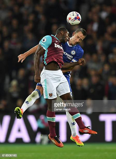 Michail Antonio of West Ham United and John Terry of Chelsea compete for a header during the EFL Cup fourth round match between West Ham United and...