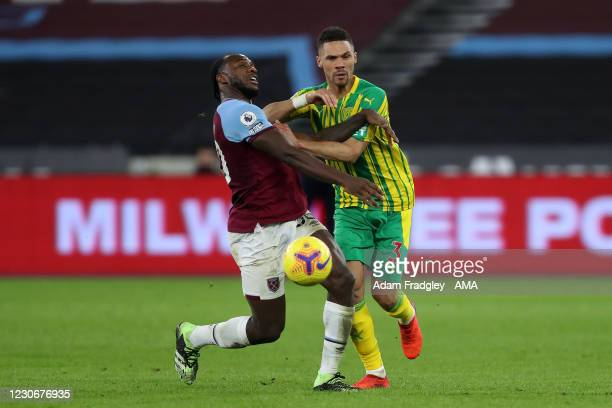 Michail Antonio of West Ham United and Kieran Gibbs of West Bromwich Albion during the Premier League match between West Ham United and West Bromwich...