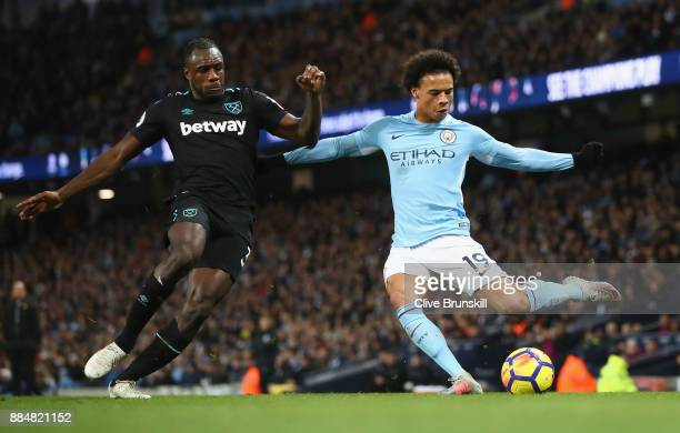 Michail Antonio of West Ham United and Leroy Sane of Manchester City battle for possession during the Premier League match between Manchester City...