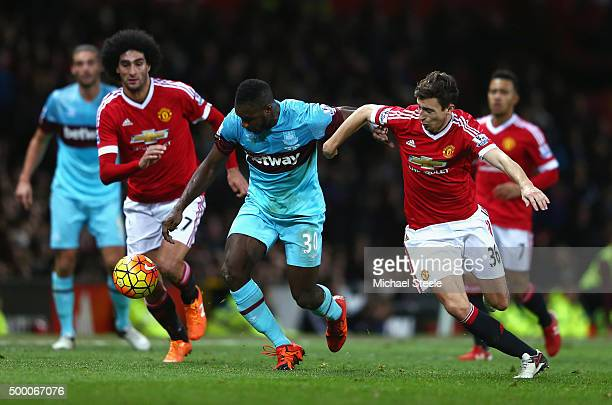 Michail Antonio of West Ham United and Matteo Darmian of Manchester United compete for the ball during the Barclays Premier League match between...