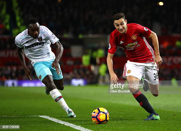 Michail Antonio of West Ham United and Matteo Darmian of Manchester United chase after the ball during the Premier League match between Manchester...