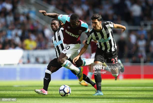 Michail Antonio of West Ham United and Mikel Merino of Newcastle United battle for possession during the Premier League match between Newcastle...