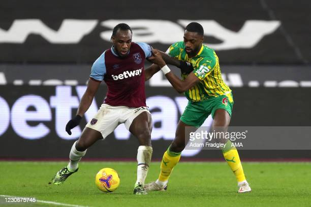 Michail Antonio of West Ham United and Semi Ajayi of West Bromwich Albion during the Premier League match between West Ham United and West Bromwich...