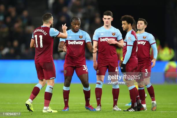 Michail Antonio of West Ham United and team mates in conversation during the Premier League match between West Ham United and Arsenal FC at London...
