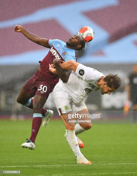 Michail Antonio of West Ham United battles for possession with James Tarkowski of Burnley during the Premier League match between West Ham United and...