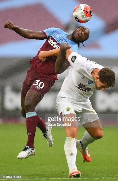 Michail Antonio of West Ham United battles with James Tarkowski of Burnley during the Premier League match between West Ham United and Burnley FC at...