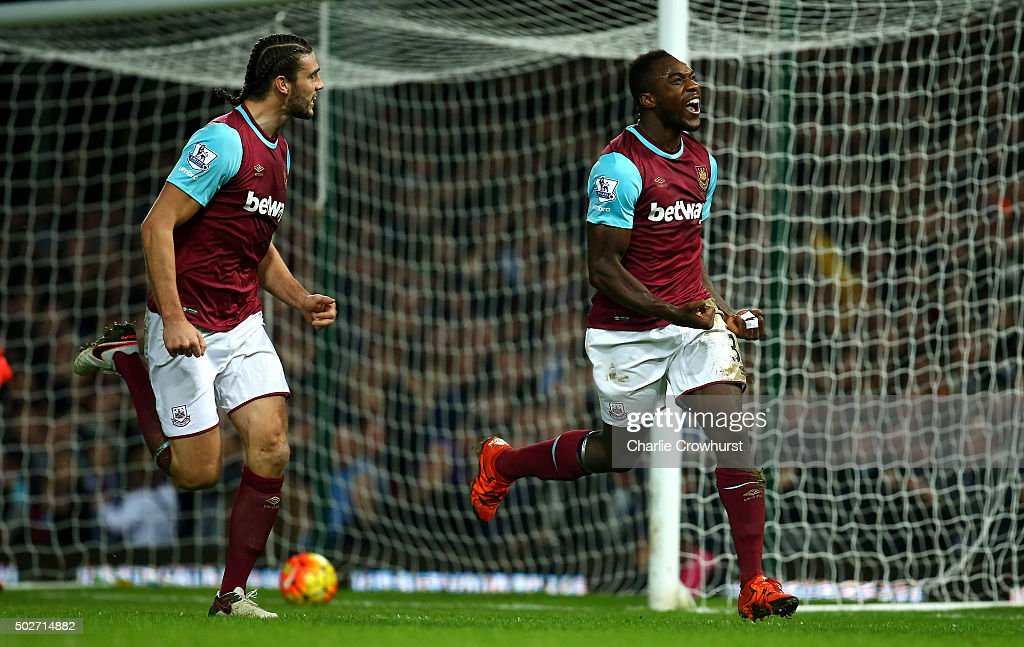 Michail Antonio of West Ham United (r) celebrates after deflecting the ball into the net for his side's first goal during the Barclays Premier League match between West Ham United and Southampton at the Boleyn Ground on December 28, 2015 in London, England.