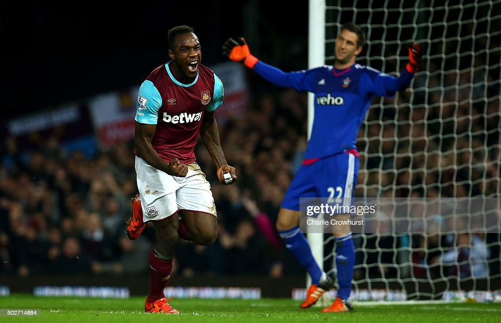 Michail Antonio of West Ham United celebrates after deflecting the ball into the net for his side's first goal during the Barclays Premier League match between West Ham United and Southampton at the Boleyn Ground on December 28, 2015 in London, England.