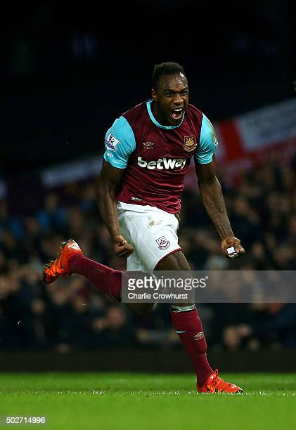 Michail Antonio of West Ham United celebrates after deflecting the ball into the net for his side's first goal during the Barclays Premier League...