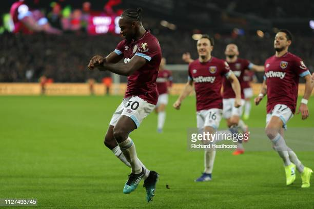 Michail Antonio of West Ham United celebrates after scoring his team's first goal during the Premier League match between West Ham United and...