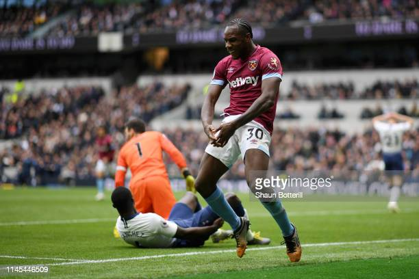 Michail Antonio of West Ham United celebrates after scoring his team's first goal during the Premier League match between Tottenham Hotspur and West...