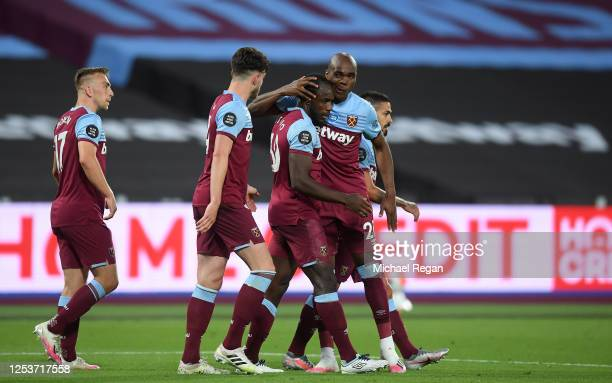 Michail Antonio of West Ham United celebrates after scoring his team's second goal with team mates during the Premier League match between West Ham...