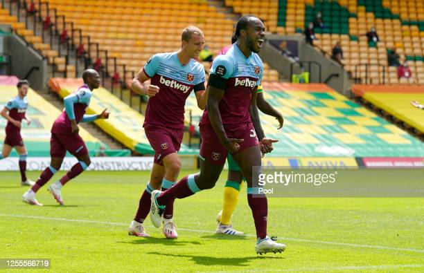 Michail Antonio of West Ham United celebrates after scoring his team's first goal during the Premier League match between Norwich City and West Ham...