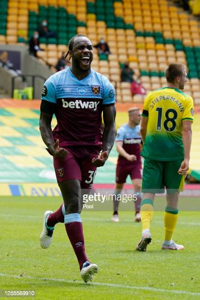 Michail Antonio of West Ham United celebrates after scoring his team's second goal during the Premier League match between Norwich City and West Ham...