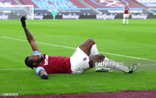 Michail Antonio of West Ham United celebrates after scoring his team's first goal during the Premier League match between West Ham United and Burnley...