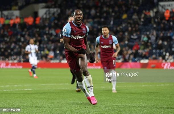 Michail Antonio of West Ham United celebrates after scoring his team's third goal during the Premier League match between West Bromwich Albion and...