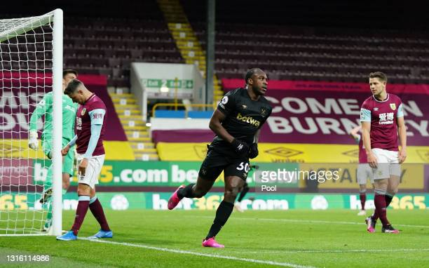 Michail Antonio of West Ham United celebrates after scoring their side's first goal during the Premier League match between Burnley and West Ham...