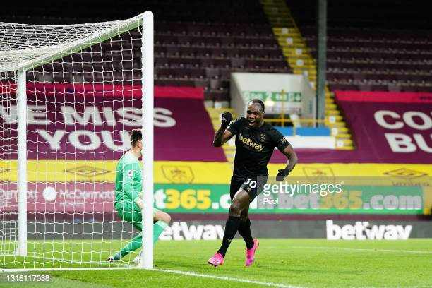 Michail Antonio of West Ham United celebrates after scoring their side's second goal during the Premier League match between Burnley and West Ham...