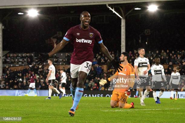 Michail Antonio of West Ham United celebrates his goal past Sergio Rico of Fulham during the Premier League match between Fulham FC and West Ham...